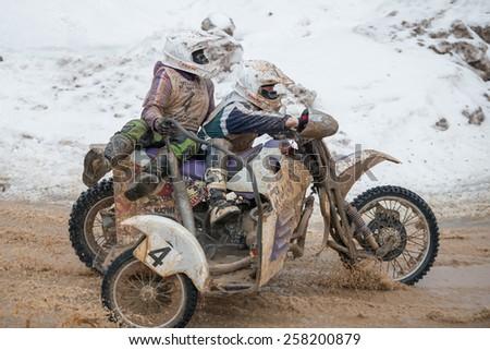 BORODINO, RUSSIA - FEBRUARY 1: A. Wolf / A. Hvorostyn (4) team TK Yunost at the All-Russian motocross named VP Chkalov on February 1, 2015 in Borodino, motor track motorcycle club Gallaks, Russia - stock photo
