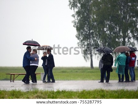 BORODINO, RUSSIA - JUNE 20, 2015:People dance in the rain on the Borodino field.
