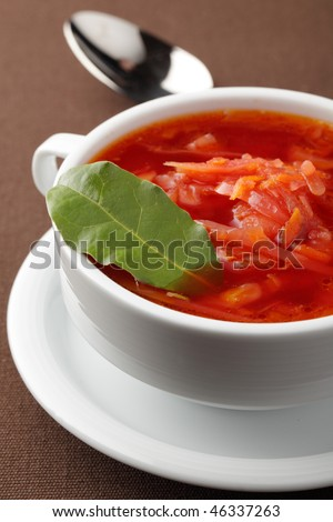 Borscht, Russian beetroot soup with bay leaf - stock photo