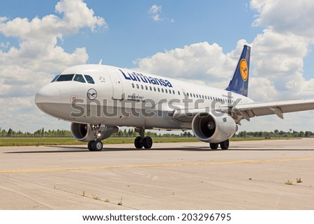 Boryspil (UKBB/KBP) Airport, Ukraine - July 5, 2014. Lufthansa Airbus A319 taxiing to the gate after landing.  - stock photo