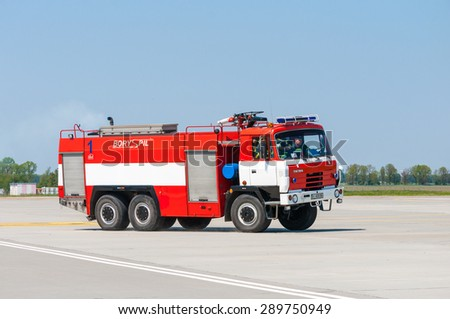 BORYSPIL, UKRAINE - MAY, 20, 2015: Red firetruck Tatra ride on call fire suppression and mine victim assistance at Boryspil International Airport, Kiev, Ukraine.  - stock photo