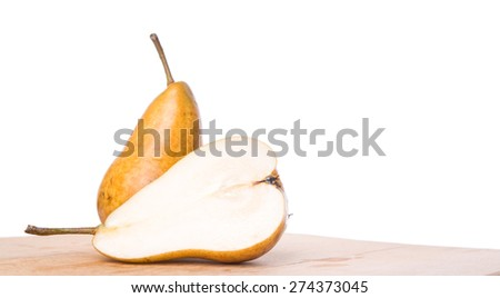 Bosc pear fruit on wooden surface