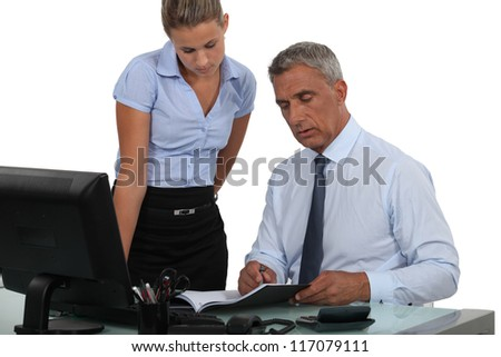 Boss and employee working close together