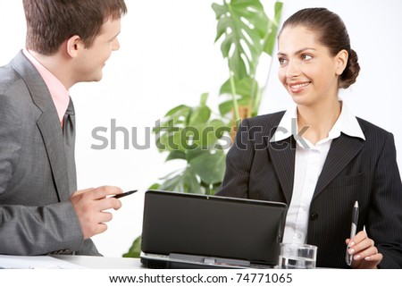 Boss and secretary discussing plan at meeting in office - stock photo
