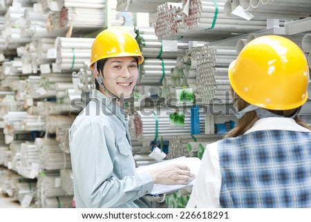 Boss and subordinate working in warehouse - stock photo