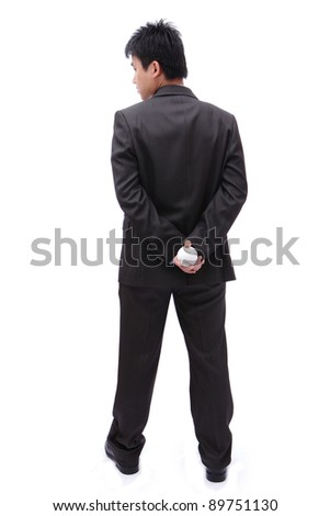 Boss (Business man) holding ball in his back - stock photo
