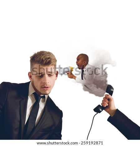 Boss chides an employee on the phone - stock photo