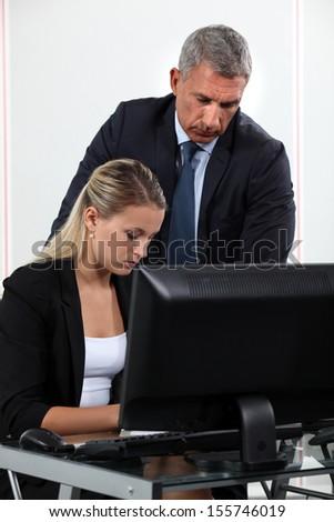 Boss explaining something to colleague - stock photo