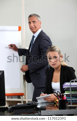 Boss explaining theory to assistant - stock photo