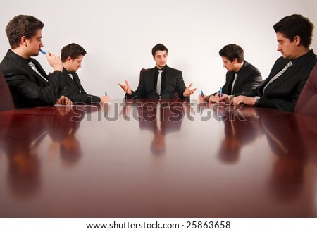 Boss explains expansion strategy to employees. - stock photo