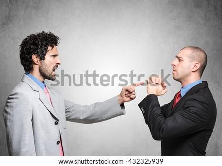 Boss firing a supplicating employee - stock photo