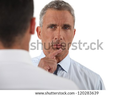 Boss giving orders to employee - stock photo