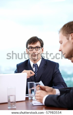 Boss holds a meeting in his office - stock photo