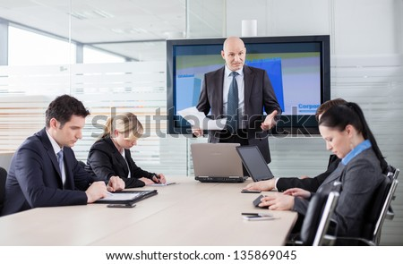 Boss in a bad mood because of bad results, telling his employees they're incompetent - stock photo