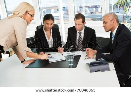 Boss insctructing business team - stock photo