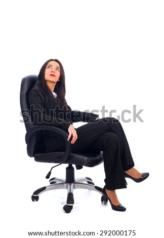 Boss looking upwards sitting in the office chair. - stock photo