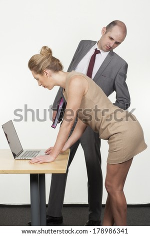 http://thumb7.shutterstock.com/display_pic_with_logo/350431/178986341/stock-photo-boss-ogling-his-secretary-leaning-over-to-look-up-her-skirt-as-she-leans-over-a-table-reading-178986341.jpg