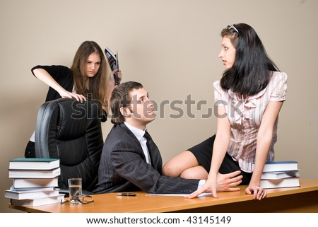 Boss on chair and him secretary sitting on table