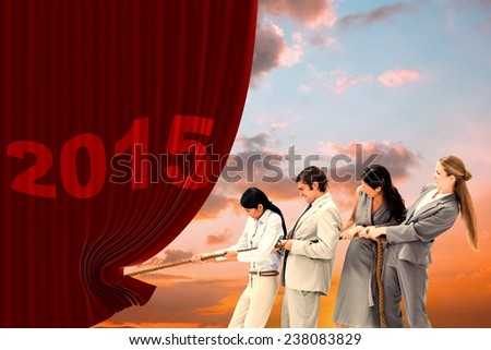 Boss pulling a rope against his employees against orange and blue sky with clouds - stock photo