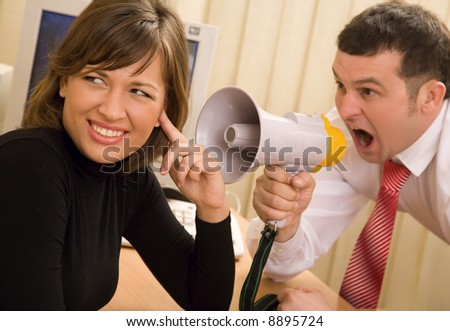 Boss shouting at office at businesswoman - stock photo