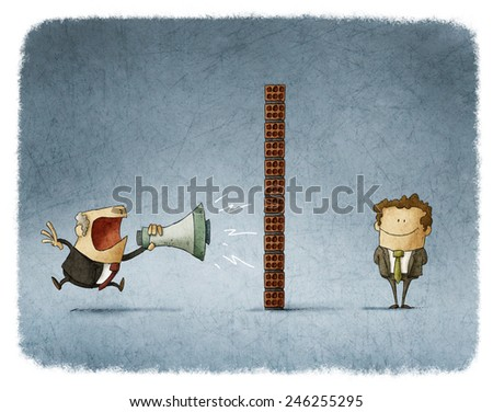 boss shouting with a megaphone to an employee who is behind a brick wall and does not get any sound - stock photo