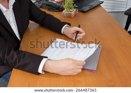 Boss signing a business contract - stock photo