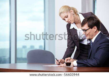 Boss signs the documents brought by the secretary - stock photo