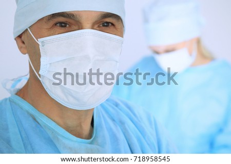 Boss surgeon is examining the operation while medical team are busy of patient. Medicine, healthcare and emergency in hospital