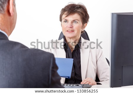 Boss talking to candidates - stock photo