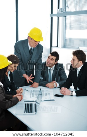 Boss talking to colleagues - stock photo