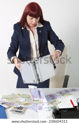 boss woman with a lot of money - stock photo