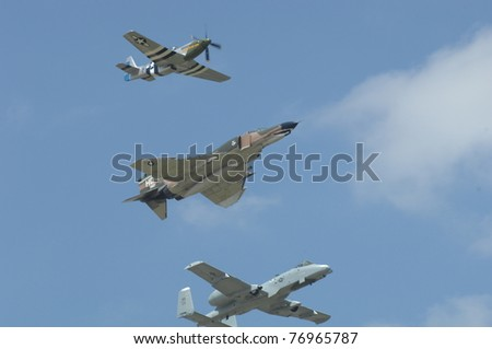 BOSSIER CITY, LA - MAY 8: A WWII P-51, USAF F-4 & an A-10 perform a Heritage formation flypast during an air demonstration for the Barksdale AFB airshow on May 8, 2011 in Bossier City, LA. - stock photo