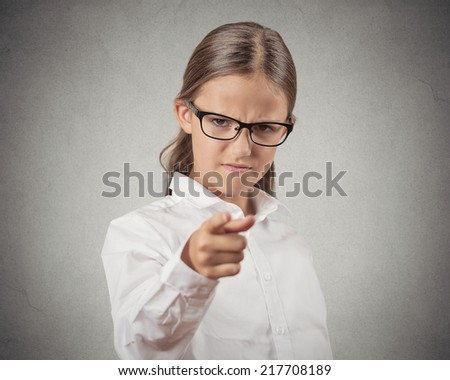 Bossy. Closeup portrait angry mad teenager girl disguised as boss, teacher businesswoman pointing finger at you displeased isolated grey background. Human face expression emotion feeling body language - stock photo