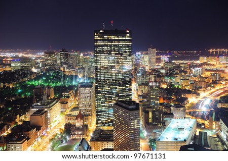 Boston aerial view with skyscrapers at night with city skyline illuminated. - stock photo