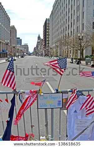 BOSTON - APR 20: American flags on Memorial set up on Boylston Street in Boston, USA on April 20, 2013. 3 people killed and over 100s injured during Boston Marathon bombing on April 15, 2013. - stock photo