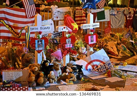 BOSTON-APR 18:Memorial from flowers on Boylston Str. in Boston,USA on April 18,2013.More 23300 runners take part in Marathon.3 people killed,over 100s injured during Marathon bombing on April 15,2013. - stock photo