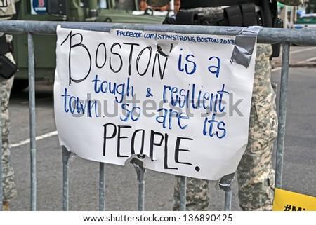 BOSTON - APR 20: Memorial set up on Boylston Street in Boston, USA on April 20, 2013. 3 people killed and over 100s injured during Boston Marathon bombing on April 15, 2013. - stock photo