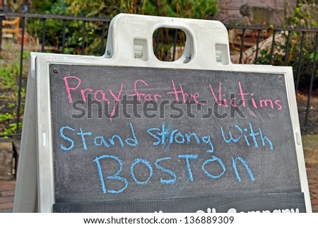 BOSTON - APR 20: Pray for the victims as text near Boylston Street in Boston, USA on April 20, 2013. 3 people killed and over 100s injured during Boston Marathon bombing on April 15, 2013. - stock photo