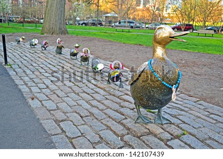 """BOSTON-APR 20:Sculpture of ducks tribute to Robert McCloskeys story """"Make way for ducklings"""" open in Boston Public Garden in 1987. Boston Strong as respect to Boston Marathon victims on April 15,2013. - stock photo"""