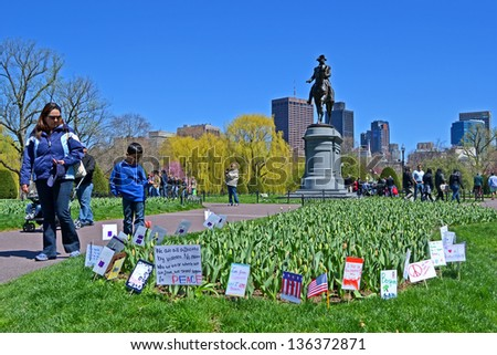 BOSTON-APR 21:Support flags near Washington monument in Public Garden in Boston,USA on Apr 21,2013.More 23300 runners take part in marathon.3 were killed,over 100s injured while bombing on APR 15. - stock photo