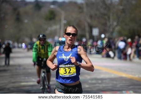 BOSTON - APRIL 18: Caroline White races up the Heartbreak Hill during the Boston Marathon April 18, 2011 in Boston. Caroline Kilel (Kenya) won the women's category with 2:22:36. - stock photo