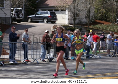BOSTON - APRIL 18: Elite women race up the Heartbreak Hill during the Boston Marathon April 18, 2016 in Boston.