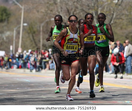 BOSTON - APRIL 18: Elite Women runners races up the Heartbreak Hill during the Boston Marathon April 18, 2011 in Boston.  Caroline Kilel  (Kenya) won the womens category with 2:22:36. - stock photo