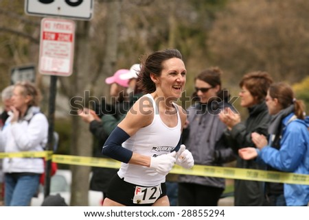 BOSTON - APRIL 20 : Lisa Veneziano races up the Heartbreak Hill before finishing 15th during the Boston Marathon April 20, 2009 in Boston. About 25,000 runners took part in the 113th edition. - stock photo