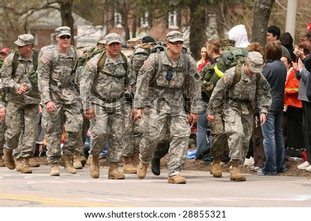 BOSTON - APRIL 20 : Marines and soldiers run in full 50 pound packs in solidarity with 15 amputee soldiers competing in the marathon during the Boston Marathon April 20, 2009 in Boston. - stock photo