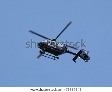 BOSTON - APRIL 18 : Massachusetts State Police Helicopter patrols from above as nearly 25000 runners participated in the Boston Marathon on April 18, 2011 in Boston. - stock photo