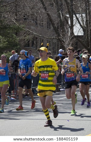 BOSTON - APRIL 21 : Nearly 36000  runners participated in the Boston Marathon on April 21, 2014 in Boston. Meb Keflezighi (USA) finished first with a time of 2:08:37. - stock photo