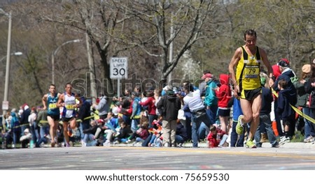 BOSTON - APRIL 18 : Nearly 25000 runners participated in the Boston Marathon on April 18, 2011 in Boston. Geoffrey Mutai (Kenya) finished first with a time of 2:03:02. - stock photo