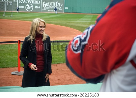 BOSTON - APRIL 7: NESN broadcaster Heidi Watney smiles for fans taking photos at the Boston Red Sox Opening Day at historical Fenway Park April 7, 2009 in Boston, Massachusetts. - stock photo