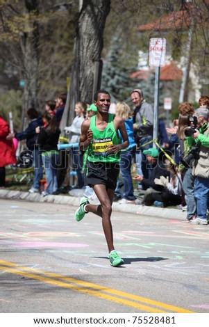 BOSTON - APRIL 18 : Runners race up Heartbreak Hill during the Boston Marathon April 18, 2011 in Boston. Geoffrey Mutai (Kenya) finished in 2:03:02. - stock photo